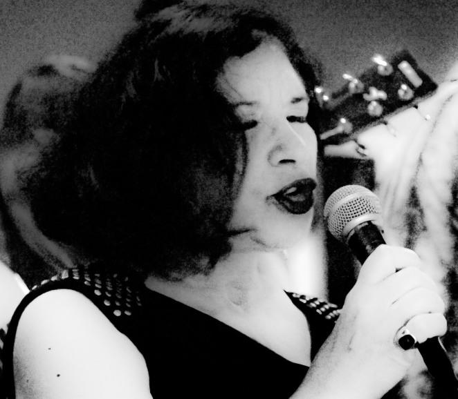 Carole singing